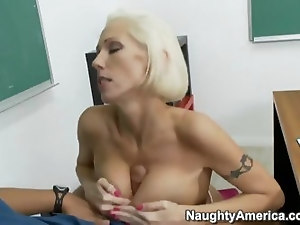 Mature blond hottie Kasey Grant with big fake tits getting fucked in classroom by Rocco Reed in her shaved pussy in a hardcore style after an amazing